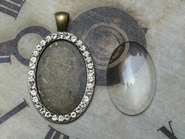 Glascabochon oval, bronze, Rahmen m. Strass außen